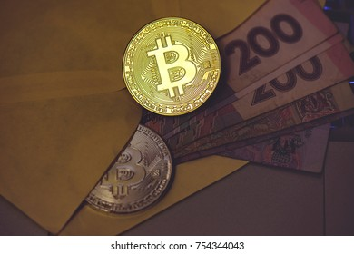 Bitcoin gold coin lies in an envelope with money. The concept of virtual crypto currency.