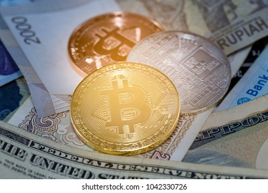 Bitcoin gold coin on bank note. Selective focus on golden. Virtual cryptocurrency concept.