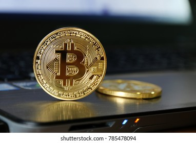Bitcoin gold coin on the tablet Electronic money concept