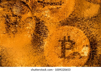 Bitcoin gold coins on a gold background
