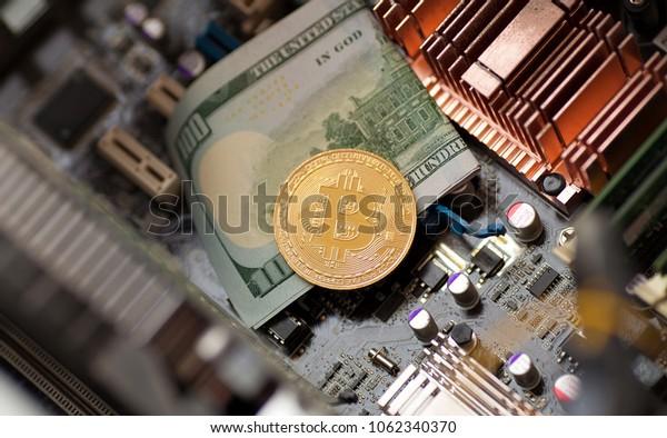 Bitcoin. Gold Bitcoin electronic computer processor board.