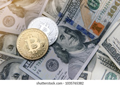 Bitcoin gold and silver coins on US dollar banknotes. Electronic money investment. Cryptocurrency business concept.
