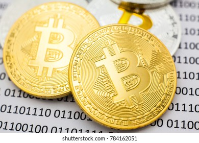 Bitcoin Gold Silver on binary digital background.