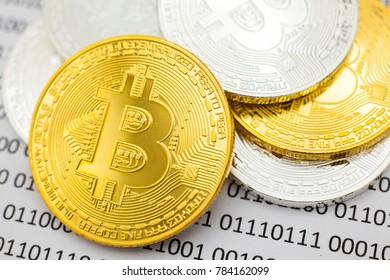 Bitcoin Gold Silver on binary digital background.