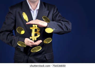 bitcoin gold symbols in a man hand