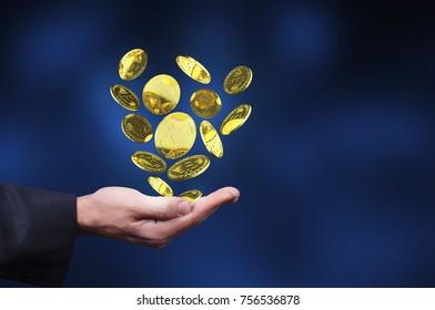 bitcoin gold symbols in a man hand