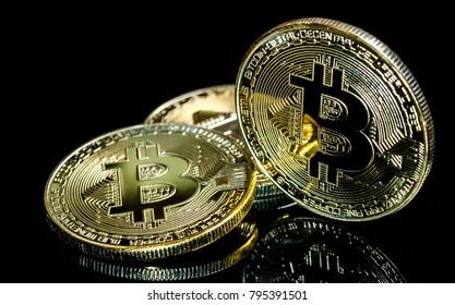 Bitcoin, Golden Bitcoins on a black background .Photo new virtual money