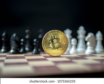Bitcoin, Golden coin with black and white chess isolated on black background.