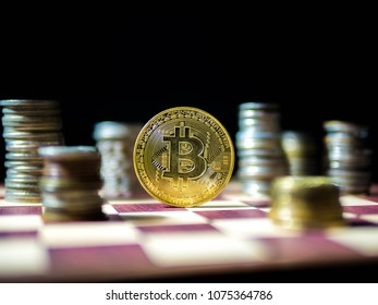 Bitcoin, Golden coin with coin different currencies isolated on black background.