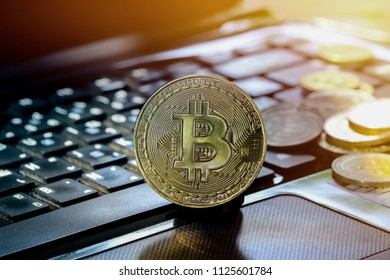 Bitcoin golden coin New virtual money on keyboard background, Crypt o currency, Business and Trading concept