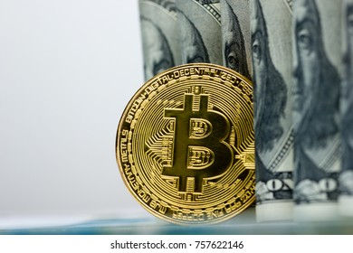 Bitcoin golden coin New virtual money and dollar background . Cryptocurrency. Business and Trading concept.