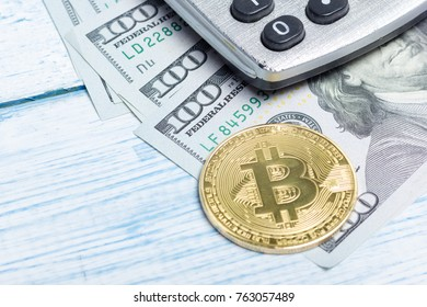 Bitcoin golden coin New virtual money and dollar background . Cryptocurrency. Business and Trading concept. Close-up shot