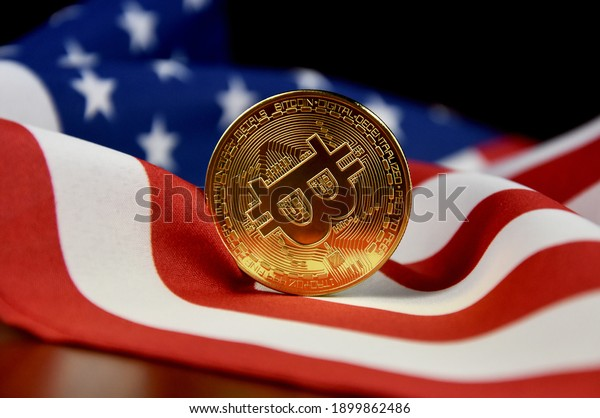 Bitcoin golden coin on american flag stock images. Cryptocurrency with american flag images. Digital gold images. Beautiful gold bitcoin coin photo images