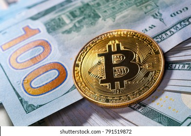 Bitcoin golden coin on dollar background . Cryptocurrency. Business and Trading concept. Closeup