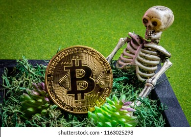 Bitcoin in a graveyard and a skeleton.