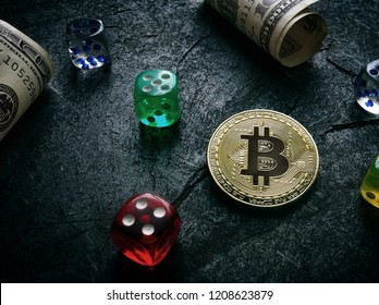 Bitcoin with hundred dollar bills and dice