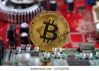 Bitcoin and integrated circuit on background. Advanced technology concept background.