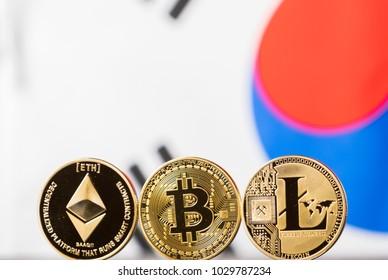 Bitcoin, litecoin and ethereum against South Korean flag