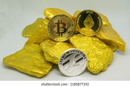bitcoin, litecoin and ethereum coins on gold chunks