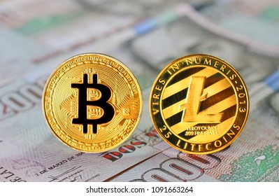 Bitcoin and Litecoin on Colombian Pesos Banknotes Background , Cryptocurrency concept