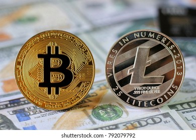 Bitcoin and Litecoin on Us Dollars banknotes background with credit cards