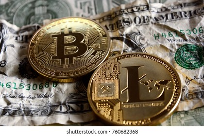 Bitcoin and Litecoin over crushed dollar banknotes. Cryptocurrency conspiracy concept .