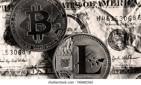 Bitcoin and Litecoin over dollar banknotes on black and white tones. Cryptocurrency Trading concept .