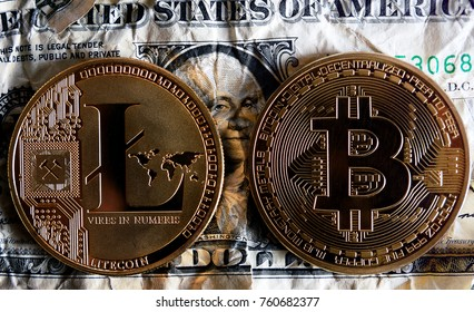 Bitcoin and Litecoin over dollar banknotes. Cryptocurrency Trading concept .