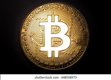 bitcoin logo glows in lights