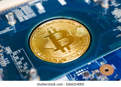 Bitcoin lying in the electronic motherboard of a laptop