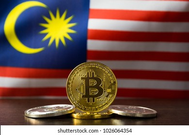 Bitcoin and Malaysia Flag. Concept for investors in cryptocurrency and Blockchain Technology in Malaysia.