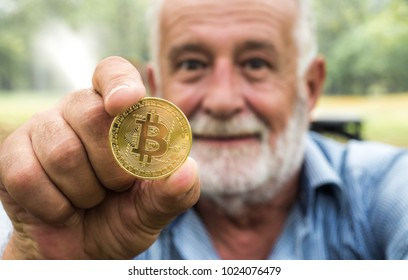 Bitcoin, Man holding Golden coin in hand