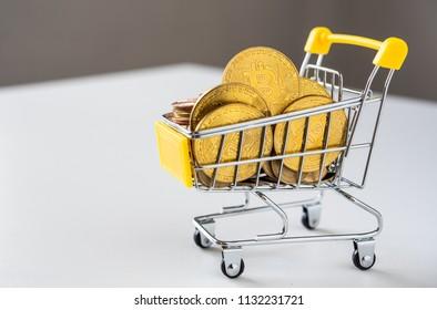 Bitcoin in mini shopping cart   to shopping online concept
