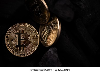 Bitcoin mining concept. Bitcoin cuurency on charcoal. Close up details
