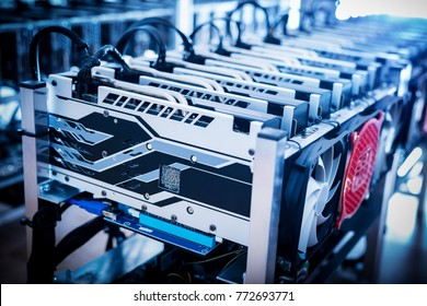 Bitcoin mining devices standing in a row. Cryptocurrency business.