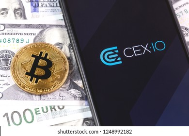 bitcoin, money and CEX.IO app on the screen smartphone and notebook. CEX.IO - one of the largest cryptocurrency exchange on the market. Moscow, Russia - December 4, 2018