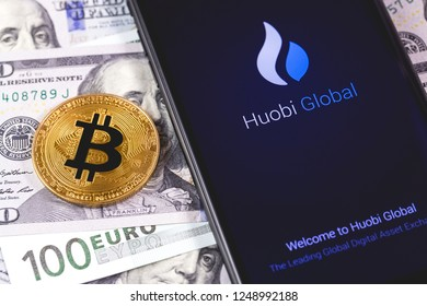 bitcoin, money and Huobi app on the screen smartphone. Huobi - one of the largest cryptocurrency exchange on the market. Moscow, Russia - December 4, 2018