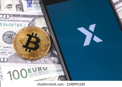 bitcoin, money and Poloniex app on the screen smartphone and notebook. Poloniex - one of the largest cryptocurrency exchange on the market. Moscow, Russia - December 4, 2018