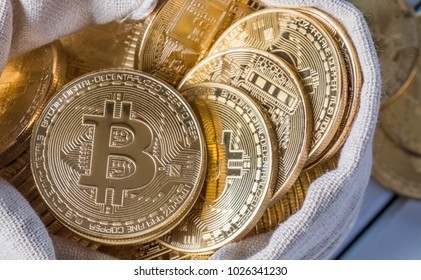 Bitcoin in money pouch over white wooden table top