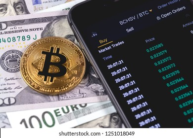 bitcoin, money and smartphone with Bianace cryptocurrency stock market closeup. Moscow, Russia - December 4, 2018