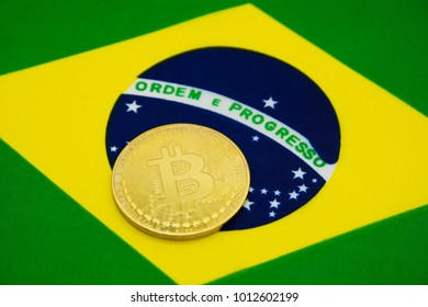 bitcoin on a background of a flag Brazil