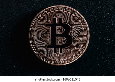 Bitcoin on black background. Photo in the dark key. Macro photo.