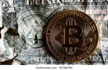 Bitcoin on Crushed dollar banknote.Concept of  Monetary system collapse .