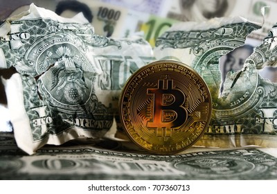 Bitcoin on Crushed US dollar and euro  banknotes. Concept of  Monetary system collapse .