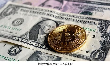 Bitcoin on  dollar banknotes. Trading concept