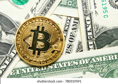 Bitcoin on dollar bills background