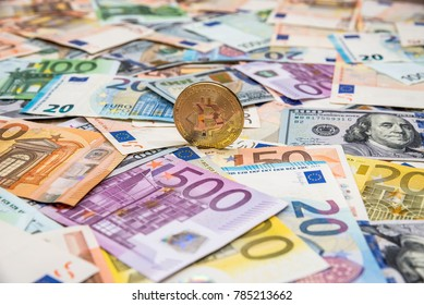 Bitcoin on dollar and euro banknotes