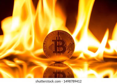 bitcoin on fire flames background