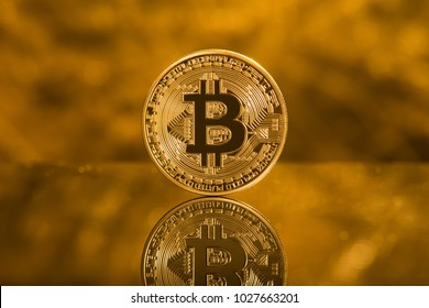 Bitcoin on a gold background.