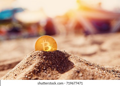 Bitcoin on golden sand, in background sea. Concept freelance, stock exchange.